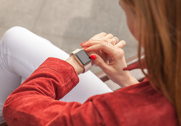 Young Woman Use Smart Watch With Blank Screen Outdoor Photograph by S_Chum
