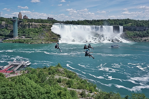 Ziplining by Niagara Falls, a new attraction for thrill seekers, a fun way to experience the natural wonder Photograph by Jana Kriz