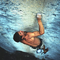 A Caucasian Man Rock Climbing by Bobby Model