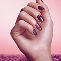 Woman Hand With Purple Nail Polish by Oleksiy Maksymenko