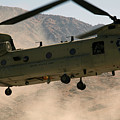 A Ch-47 Chinook Helicopter Kicks by Stocktrek Images