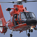 A Coast Guard Mh-65 Dolphin Helicopter by Stocktrek Images