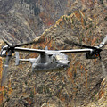 A Cv-22 Osprey Flies Over The Canyons by Stocktrek Images