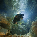 A Diver Ascends A Deep Shaft In Dans by Wes C. Skiles
