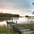 A Dock On A Lake At Sunrise Near Wawa by Susan Dykstra