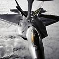 A Kc-135 Stratotanker Refuels A F-22 by Stocktrek Images