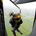 A Paratrooper Executes An Airborne Jump by Stocktrek Images