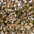 A Poor Neighborhood In Urban Maputo by Michael Fay