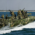 A Riverine Command Boat Conducts by Stocktrek Images