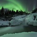 A Wintery Waterfall And Aurora Borealis by Arild Heitmann