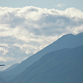 Airplane Taking Off Over The Alpine Mountains by Ian Middleton
