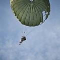 An Airman Descends Through The Sky by Stocktrek Images
