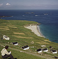 An Irishman Overlooks Cottages That by Howell Walker