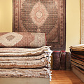 Area Rugs In A Store by Jetta Productions, Inc