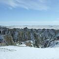 Badlands Under Snow II  by Dennis Wilkins