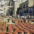 Baskets Filled With Tomatoes Stand by Luis Marden