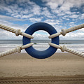 Beach Through Lifeguard Tied With Ropes by Carlos Ramos
