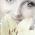 Beautiful Young Woman With A Yellow Lily by Oleksiy Maksymenko
