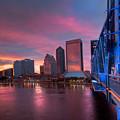 Blue Bridge Red Sky Jacksonville Skyline by Debra and Dave Vanderlaan