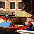 Boat With Umbrella On Canal In Venice by Michael Henderson