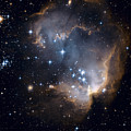 Bright Blue Newborn Stars Blast A Hole by ESA and nASA