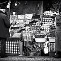 Buying Fruit by John Rizzuto