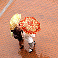 Chatting In The Rain - Umbrellas Series 1 by Carlos Alvim