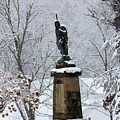 Chief John Logan Statue In The Snow by Carolyn Postelwait