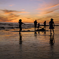 Children Playing On The Beach At Sunset by James Forte
