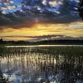 Cloudy Sunrise by Vadzim Kandratsenkau