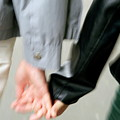 Couple Holding Hands While Strolling Down The Street by Sami Sarkis
