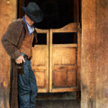Cowboy By Saloon Doors by Jill Battaglia
