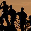 Crewmen Salute The American Flag by Stocktrek Images
