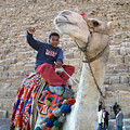 Egypt - Boy With A Camel by Munir Alawi