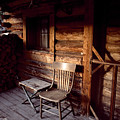 Firewood And A Chair On The Porch by Joel Sartore