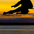 Flying Kick Over Muskegon Lake by Frederic A Reinecke