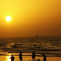 Football And Sunset At The Beach by Sunaina Serna Ahluwalia