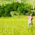 Happy Girl Enjoying Nature by Anna Om