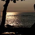 Hawaiian Dugout Canoe Race At Sunset by Michael Bessler