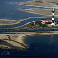 La Gacholle Lighthouse Surrounded With Blue Sea In Camargue by Sami Sarkis
