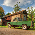 Landrover And The Barn by Rob Hawkins