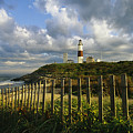 Lighthouse At Montauk With Dramatic Sky by Skip Brown