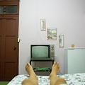 Man's Legs On A Bed In Front Of An Old Tv by Sami Sarkis