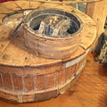 Old Grinding Wheel In A New Environment by Amelia Painter