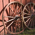 Old Wagon Wheels by Andrei Shliakhau