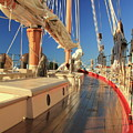 On Deck Of The Schooner Eastwind by Roupen  Baker