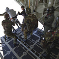 Paratroopers Jump From A C-130 Hercules by Andrew Chittock