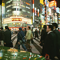 Pedestrians Cross A Crowded Tokyo by Justin Guariglia