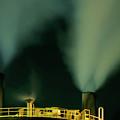 Petroleum Refinery Chimneys At Night by Sami Sarkis