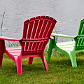 Pink And Green Lounging Chairs By The Lake by Louise Heusinkveld